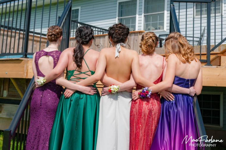 5 girls showing the back of dresses